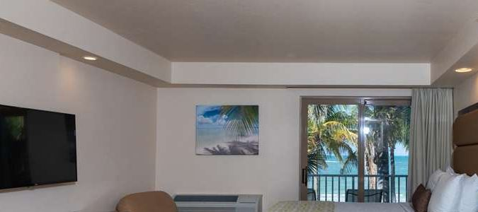 Two Double beds, Kitchen and private balcony overlooking the Gulf of Mexico